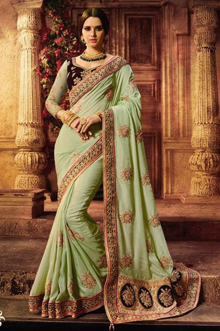 Charming Light Green Heavy Satin Wedding Wear Saree With Velvet Net Blouse